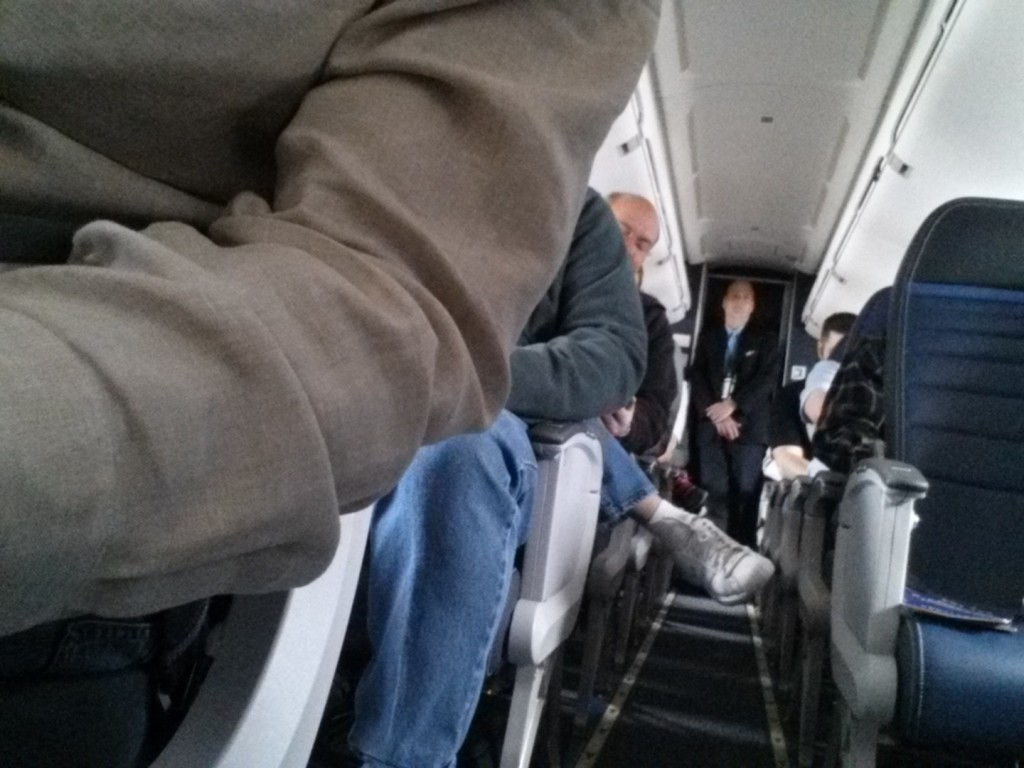 An empty seat in an exit row. Seriously?